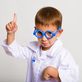 Portrait of a child in a doctor's suit royalty free stock photo