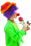 Portrait of child dressed as colorful clown Stock Image