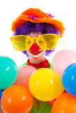 Portrait of child dressed as colorful funny clown Stock Photography