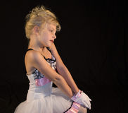 Portrait of child dressed-up. Posed portrait of child in dress against black background stock photo