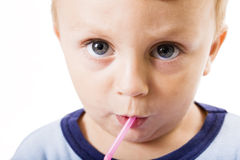 Portrait child drinking. Child drinking on white background stock photo