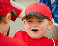 Portrait of child in dugout before baseball game Stock Photos