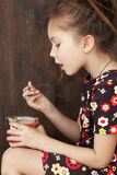Child eating dessert Royalty Free Stock Photos