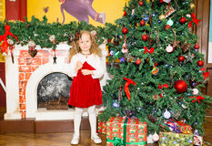 Portrait of child girl around a Christmas tree decorated. Kid on holiday new year. Portrait of child girl around  Christmas tree decorated. Kid on holiday new Royalty Free Stock Photo
