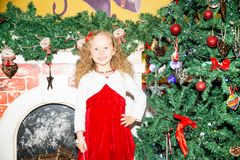 Portrait of child girl around a Christmas tree decorated. Kid on holiday new year stock image
