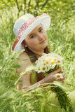 Portrait of child girl with bouquet of daisies Stock Photography