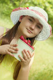 Portrait of child girl with bucket of strawberries Stock Photography