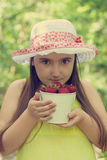 Portrait of child girl with bucket of strawberries Royalty Free Stock Photography