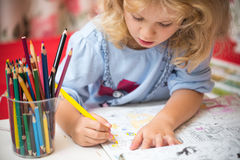Portrait of child girl drawing with pencils Stock Photos