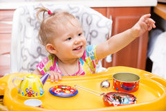 Portrait of child girl on kitchen. Use it for child, healthy food, infant formula Royalty Free Stock Images