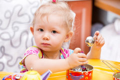 Portrait of child girl on kitchen. Use it for child, healthy food, infant formula Royalty Free Stock Photography