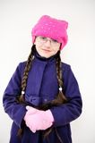 Portrait of child girl with pigtail in pink barret Royalty Free Stock Images