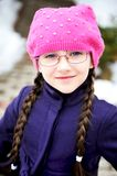 Portrait of child girl with pigtail in pink barret. Portrait of toddler girl with pigtail in pink barret and purple coat Stock Photos
