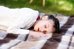 Portrait of child girl sleeping in a garden Royalty Free Stock Images