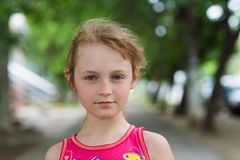 Portrait of child girl with a sly look. In summer Stock Photos