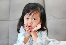 Portrait of child girl with snot flowing from her nose.  Stock Photography