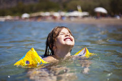 Portrait of child girl swimming in water Royalty Free Stock Photos