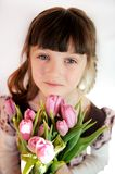 Portrait of child girl with tulips Royalty Free Stock Images