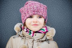 Portrait of child girl in warm autumn clothes Royalty Free Stock Photos