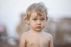 Portrait of a child with golubymi eyes on the beach Stock Photography