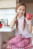 Breakfast at home. Portrait of a child having breakfast at the kitchen at home royalty free stock photo