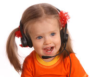 Portrait of child with headset. Royalty Free Stock Photography