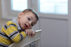 Portrait of child at highchair Royalty Free Stock Images
