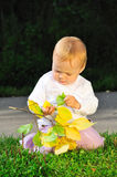 Portrait of child holding yellow leaves. In her hands Royalty Free Stock Photos