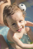 Portrait child in an inflatable pool Stock Photos