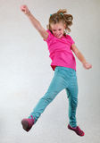Portrait of child  jumping and dancing Royalty Free Stock Photography