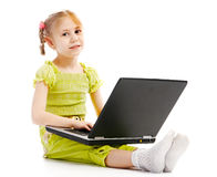 Portrait child with laptop Stock Images
