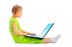 Portrait child with laptop Stock Image