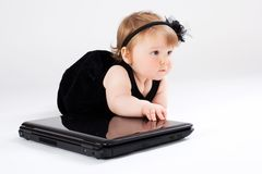 Portrait child with laptop Stock Photos