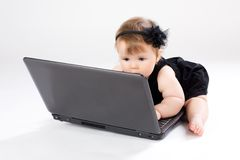 Portrait child with laptop Stock Photo