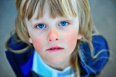 Portrait of a child with long blond hair Royalty Free Stock Image
