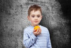 Portrait of a child with an orange Stock Photo