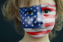Portrait of a child with a painted American flag. Closeup Stock Photography