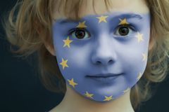 Child with a painted flag of Europe. Portrait of a child with a painted flag of Europe on her face, closeup Stock Image