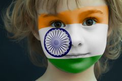 Child with a painted flag of India. Portrait of a child with a painted flag of India on her face, closeup Royalty Free Stock Photo