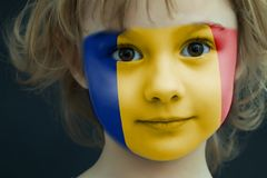 Portrait of a child with a painted Romanian flag. On her face, closeup Royalty Free Stock Photo