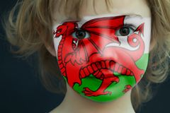 Portrait of a child with a painted Welsh flag. On her face, closeup Royalty Free Stock Photography