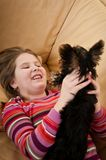 Portrait of child playing with dog Stock Images