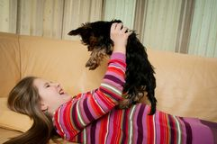 Portrait of child playing with dog Royalty Free Stock Photo