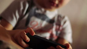 Portrait of a child playing with a smartphone stock video footage