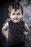 Portrait child rocker dress and funny expressions crested. Act, child rocker dress and funny expressions crested, expression Stock Photo