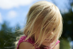 Portrait of child sad blond little girl outside royalty free stock photography