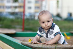 Portrait of child in sandbox Stock Photo