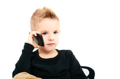 Portrait of a child speaking by phone Stock Image