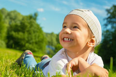 Portrait of a child on a summer nature. Portrait of a happy child on a summer nature Royalty Free Stock Image