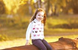 Portrait child in sunny autumn day Stock Photo